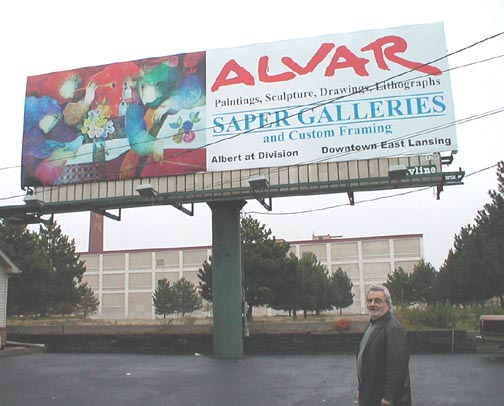 Alvar in                             front of billboard