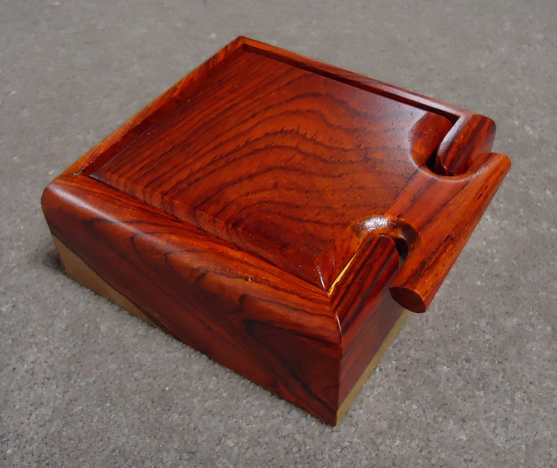 Small square box with                     T-shaped handle