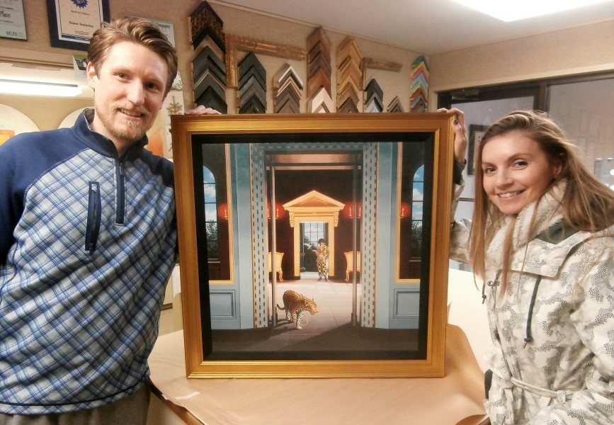 Lance and Liz picking up the framing                               of their Phillips canvas