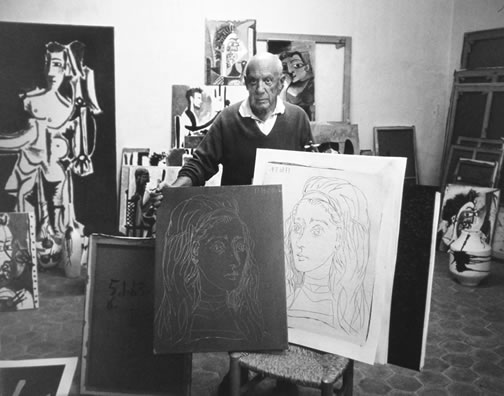 Picasso with linocut plate and print, 1957